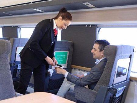 Rail staff scanning passenger's hand