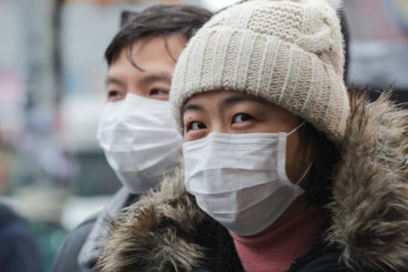 people wearing face masks to combat coronavirus covid-19